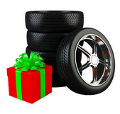 Car wheels with big red gift box — Stock Photo