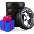 Car wheels with big gift box, white background, copyspace — Stock Photo