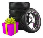 Car wheels with big gift box — Stock Photo