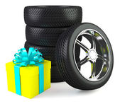 Car wheels with big gift box, white background — Stock Photo