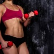 Muscled woman with barbells — Stock Photo #36269347