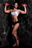 Muscled woman with barbells — Stock Photo