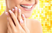 Face, hands and healthy white teeth of a woman — Stok fotoğraf
