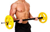 Muscular male lifting barbel — Stock Photo