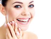 Cheerful female with fresh clear skin, white background — Stock Photo