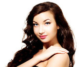 Pretty girl with long hair, white background, copyspace. — Stock Photo