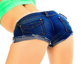Female ass in blue jeans shorts — Stock Photo