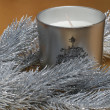 Fir tree and candle on gold background — Stock Photo #1335924