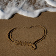 Drawn in the sand heart with the wave — Stock Photo #1339128