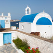 Classical Greek church with blue dome on the background of the sea on the island...  — Stock Photo