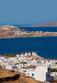 Chora Mykonos with windmills on the background of the sea and islands — Stock Photo