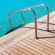 Metal railings in the pool near the wooden flooring — Stock Photo #45338453