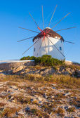 Windmill on a hill near the sea on the island of Mykonos - a pla — Stock Photo