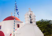 A white church with red roof at Greek town of Mykonos — Stock Photo