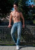 Man model in park — Stock Photo