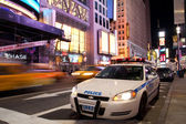 Police car on Times Square New York at night — Stock Photo