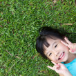 Child lying on grass — Stock Photo