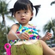 Asian baby girl on beach — Stock Photo #21356349