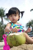 Asian baby girl on beach — Stock Photo
