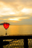 Red wine glass at sunset — Stock Photo