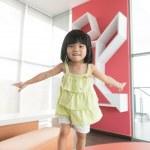 Child jumping on sofa — Stock Photo