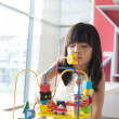 Child playing toy — Stock Photo #26690407