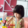 Child playing toy — Stock Photo #26690809