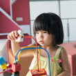 Child playing toy — Stock Photo