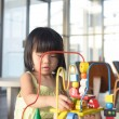 Child playing toy — Stock Photo #26690999