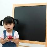 Little girl holding apple — Stock Photo #30124635