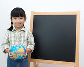 Student with globe and black board — Stockfoto