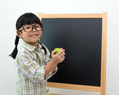 Little girl with apple in hand — Stock Photo