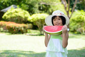 Child eating watermelon — Stock Photo