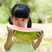 Little child eating watermelon — Stock Photo