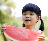 Smiling child hold watermelon — Stock Photo