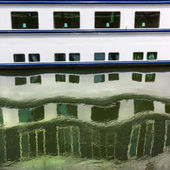Pattern of ship windows with their water reflections. — Stock Photo