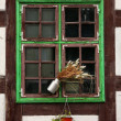 Window of half-timber medieval house. - Stock Photo