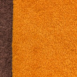 Orange and brown towel texture. — Stock Photo