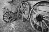 Old wooden wheels of cart. — Stock Photo