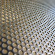 Shiny metal hole mesh pattern — Stock Photo #26186245