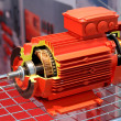 The red electric motor is presented in a cut — Stock Photo #43752681