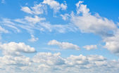 White clouds over blue sky. Nature background. — Stock Photo