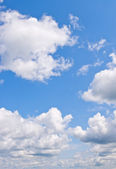 White clouds over blue sky — Stock Photo
