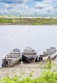 Three boats on coast of the river — Stock Photo