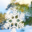 Stock Photo: Decorative snowflake on pine tree
