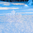 图库照片: Decorative snowflake in snow
