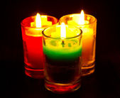 Burning colored candles — Stock Photo
