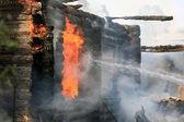 Burning wooden house — Stock Photo