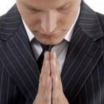 Praying young businessman — Stock Photo #1657515