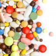 Stock Photo: Colored pills, tablets and capsules